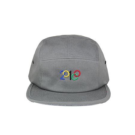 Front view of modified 2018 design with blue, yellow, black, red, and green embroidery on a grey jockey cap. KORE - Keepin Our Roots Eternal