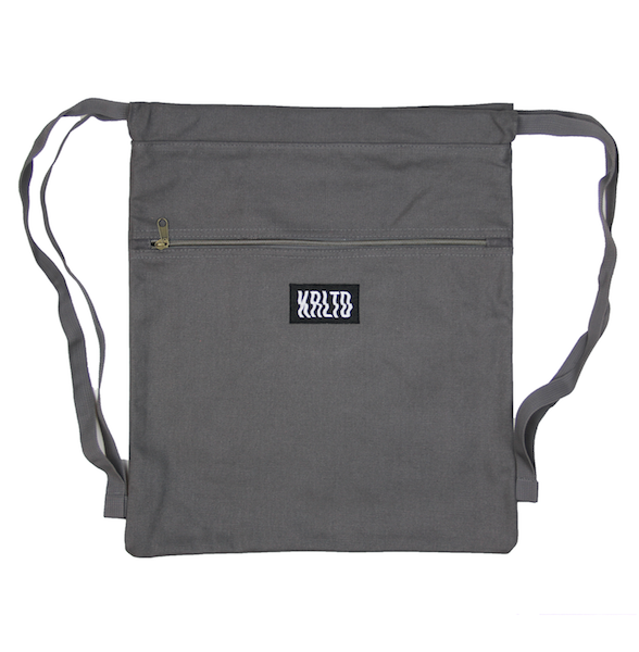 Front view of charcoal drawstring canvas bag with KRLTD embroidered below zipper.