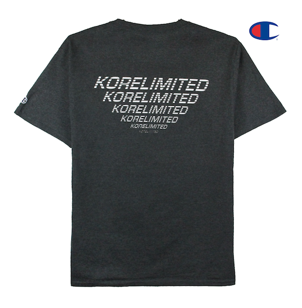 Back view image of charcoal Champion tee with Champion C logo embroidery on the sleeve and KORELIMITED print across the back. KORE - Keepin Our Roots Eternal