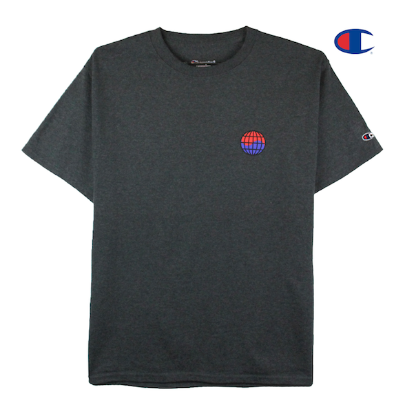 Front view image of charcoal Champion tee with Champion C logo embroidery on the sleeve and worldwide print on the front chest. KORE - Keepin Our Roots Eternal