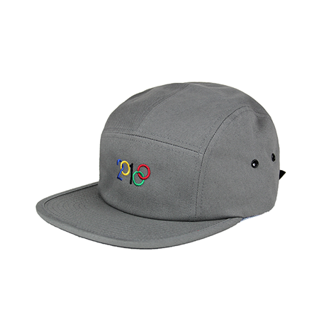 Side view of modified 2018 design with blue, yellow, black, red, and green embroidery on a grey jockey cap. KORE - Keepin Our Roots Eternal