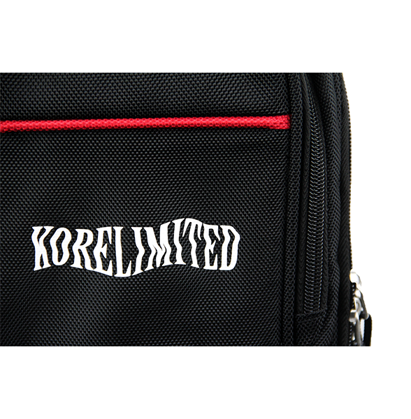 Detailed shot of black leisure pack with a Korelimited embroidery.