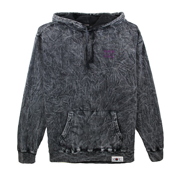 Front view of black acid wash hoodie with won over dollars embroidered on the chest.