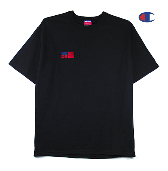 Front view of black Champion jersey tee with a minimal Korean American flag embroidered over the right chest.