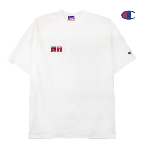 Front view of a white Champion jersey tee with a minimal Korean American flag embroidered over the right chest.