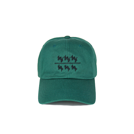 Front view of won over dollars embroidered on a green dad hat.