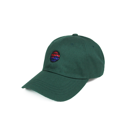 Side view of worldwide embroidered on a forest green dad hat.