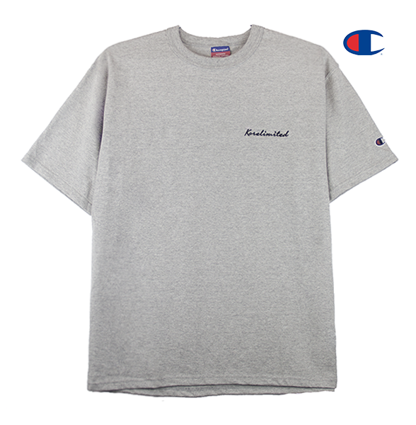 Front view of heather grey Champion jersey tee with Korelimited Script embroidered over the left chest.