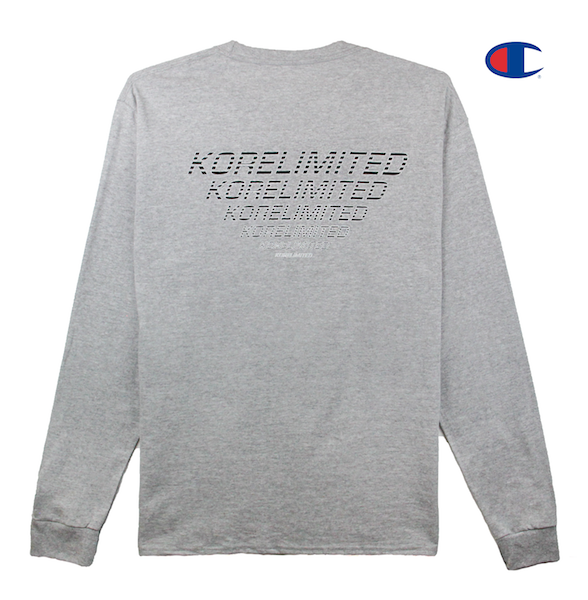 Back view of heather grey Champion long sleeve with Champion C logo embroidery on the sleeve and KORELIMITED print across the back. KORE - Keepin Our Roots Eternal