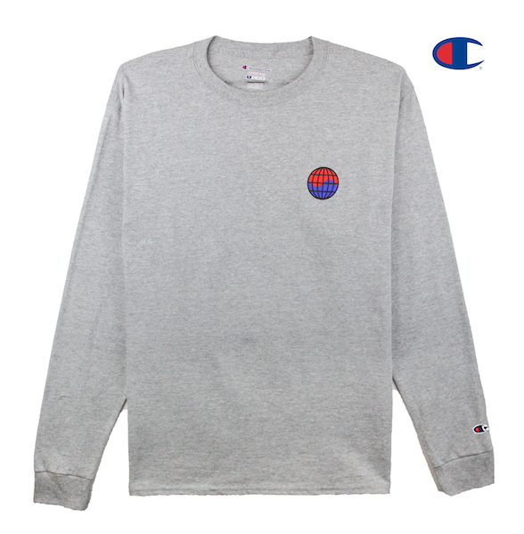 Front view of heather grey Champion long sleeve with Champion C logo embroidery on the sleeve and worldwide print on the front chest. KORE - Keepin Our Roots Eternal