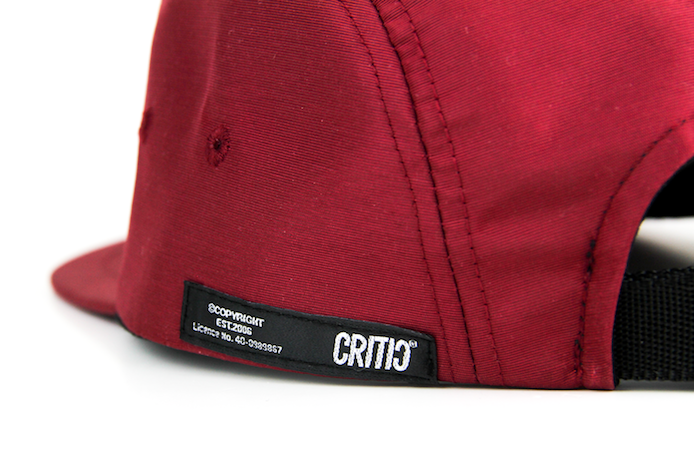 Zoomed in view of patch on the side of maroon jacket cap.