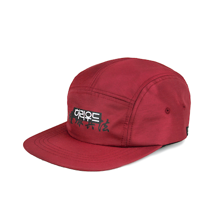 Side view of maroon jockey cap with Hollywood print on the front. KORE - Keepin Our Roots Eternal