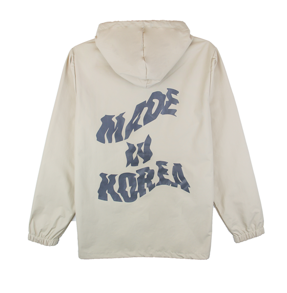 Back view of khaki jacket with made in korea printed on the back and taegeuk printed on the front.