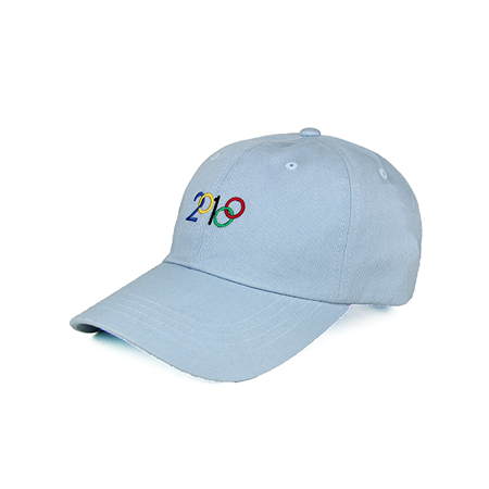 Side view of 2018 and Olympic rings embroidered on a light blue dad hat. KORE - Keepin Our Roots Eternal