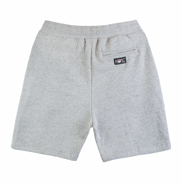 Back view of grey shorts with KORE logo printed on the bottom.