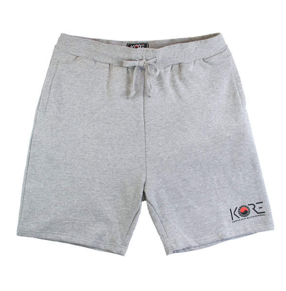 Front view of grey shorts with KORE logo printed on the bottom.