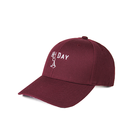 Front view of maroon curved visor cap with a mungday graphic embroidered on the front.
