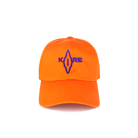 Front view of orange Korelimited washed dad hat with Korelimited patch on the front.