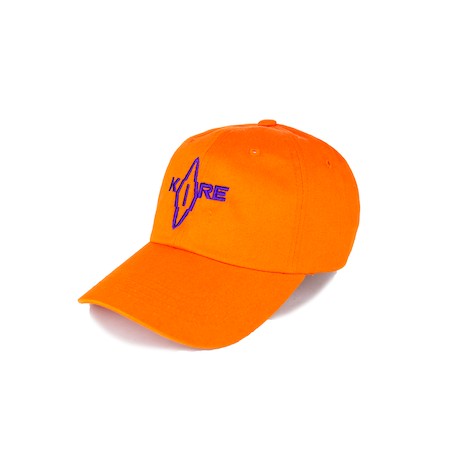 Side view of orange Korelimited washed dad hat with Korelimited patch on the front.