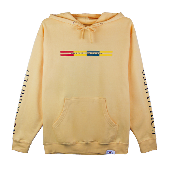 Front view of peach pullover hoodie with Goryeo Flag colors in the front. KORE Limited - Keepin Our Roots Eternal