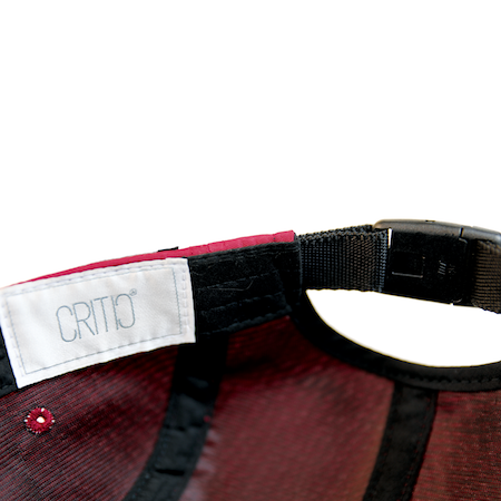 Zoomed in view of the CRITIC patch inside the maroon jockey cap.