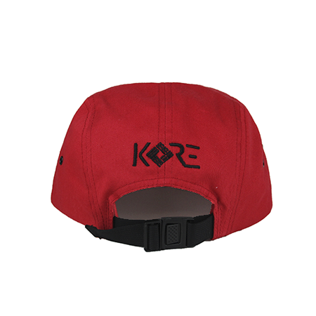 Back view of black KORE embroidery on a red jockey cap. KORE - Keepin Our Roots Eternal