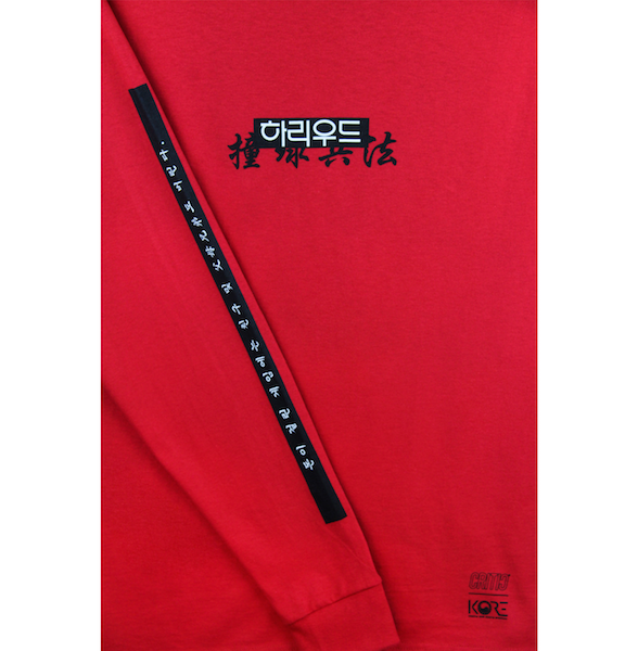 Detailed view of red Champion long sleeve with Hollywood print across the front and Korean characters along both sleeves. KORE - Keepin Our Roots Eternal