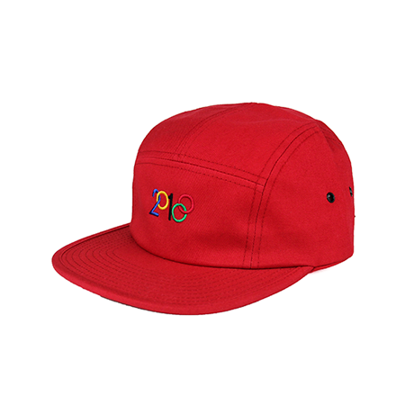Side view of modified 2018 design with blue, yellow, black, red, and green embroidery on a red jockey cap. KORE - Keepin Our Roots Eternal