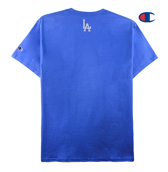 Front view of a royal blue champion tee with an arched KOREATOWN font on the chest and KORE tag stitched on the bottom seam.