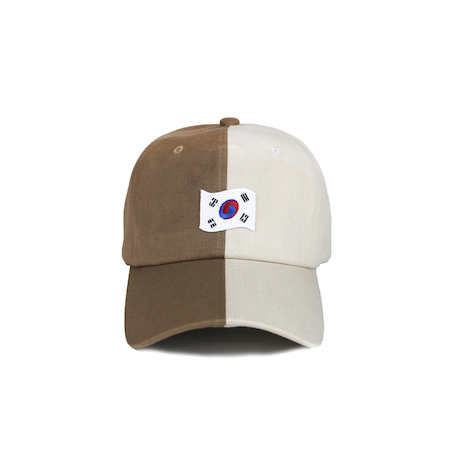 Front view of tan/light brown dad hat with 1882 flag embroidery on the front.