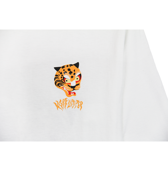 Close up view of white long sleeve with a graphic illustration of the Korean tiger's head and KORELIMITED printed underneath it. KORE Limited - Keepin Our Roots Eternal