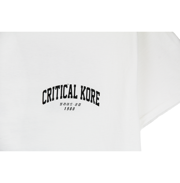 Detailed view of the front Critical KORE print on white Champion tee. KORE - Keepin Our Roots Eternal