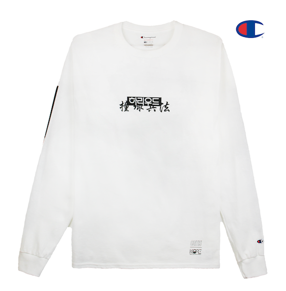 Front view of white Champion long sleeve with Hollywood print across the front. KORE - Keepin Our Roots Eternal