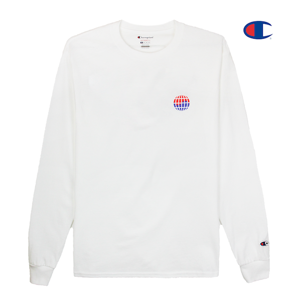 Front view of white Champion long sleeve with Champion C logo embroidery on the sleeve and worldwide print on the front chest. KORE - Keepin Our Roots Eternal