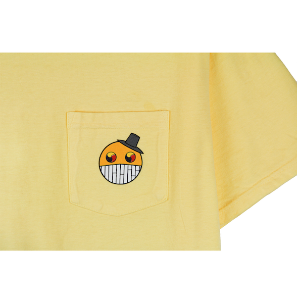 Detailed view of yellow ComfortWash pocket tee with cartoon character design on the chest.