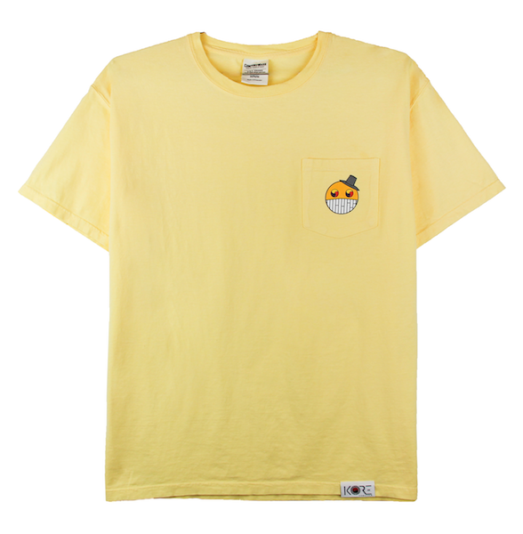 Front view of yellow ComfortWash pocket tee with cartoon character design on the chest.