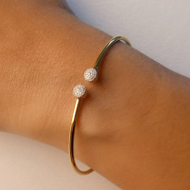 Wearing Disc Flexi Bangle in Gold with Diamonds