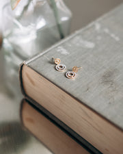 Rock Circle Earrings in Gold on a Book