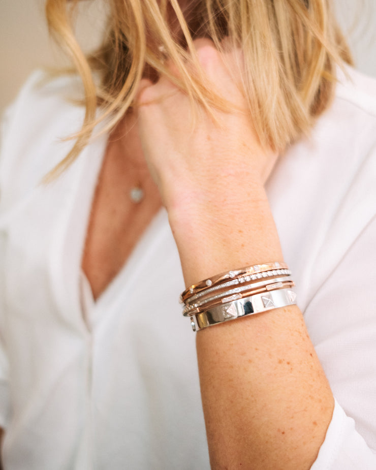 Wearing a cuff stacking including Cuff Love Cuff Bracelet