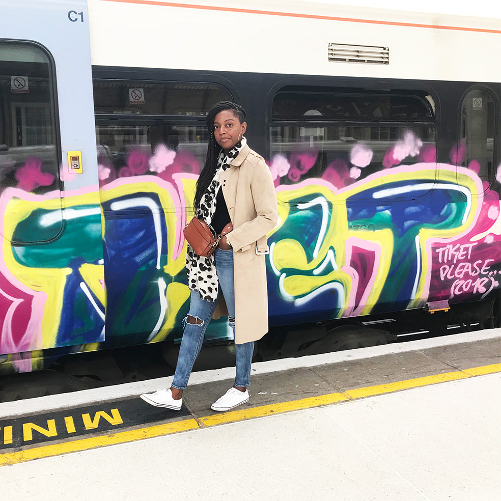 keisha in front of London train
