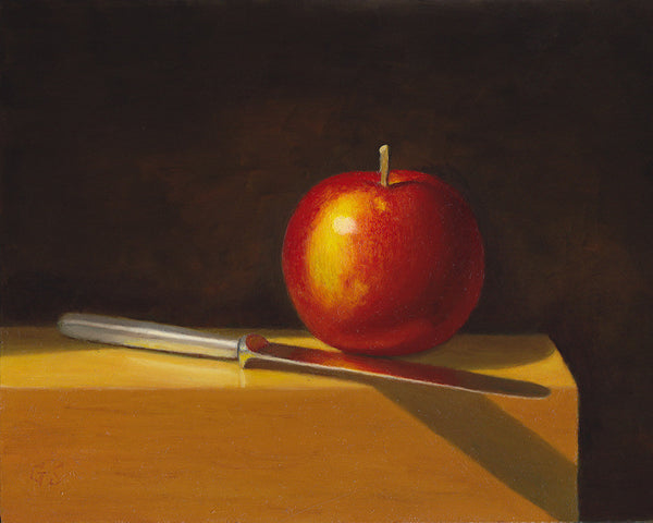 Apple and knife on wood block