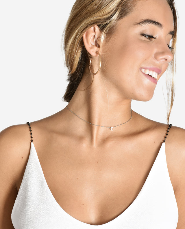 CRYSTAL Croptop blanco de tirantes con cadena con piedras negras | THE-ARE