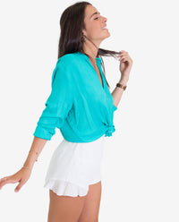 Short plumeti blanco con volante goma cintura mujer | THE-ARE