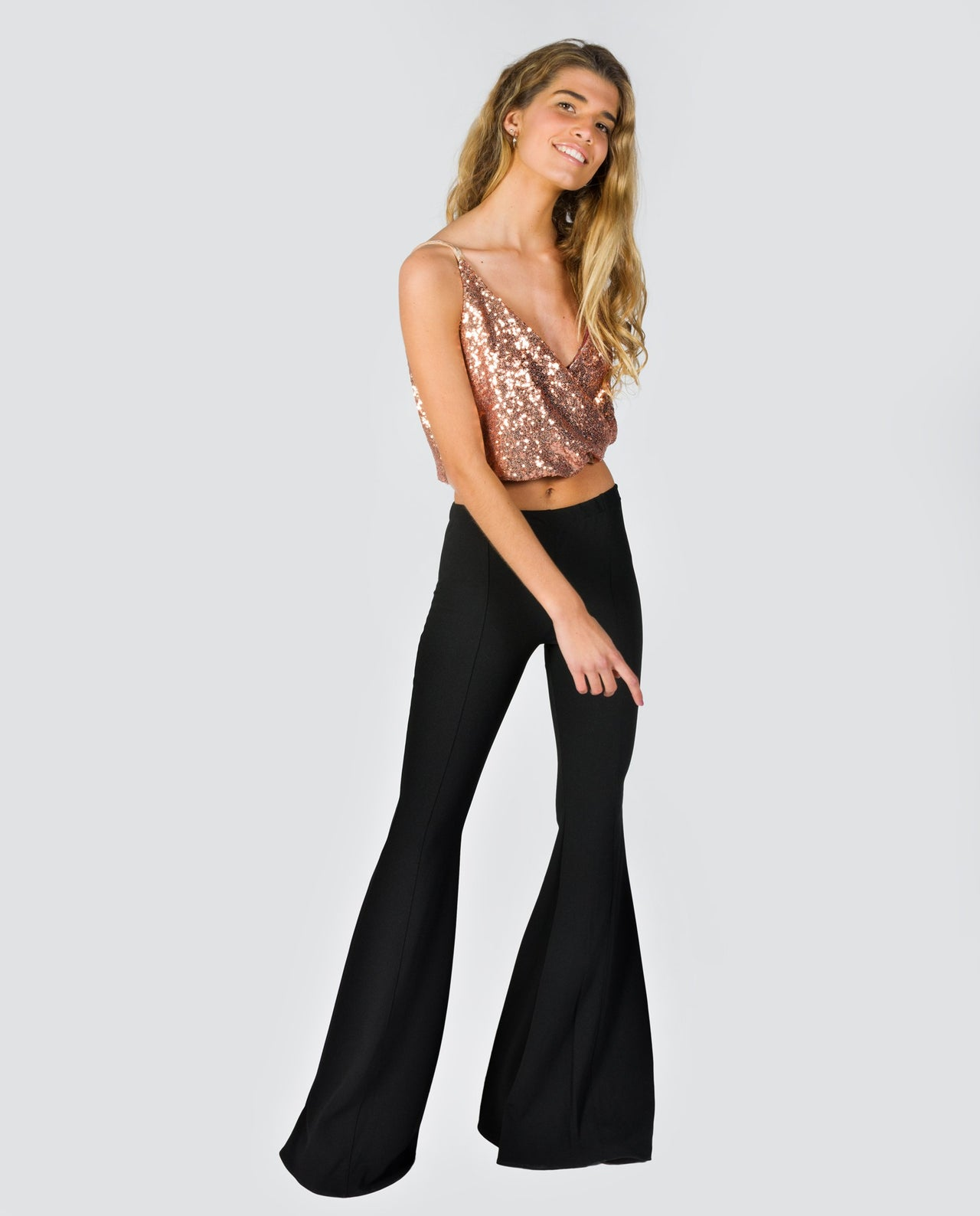 Elastic Black Flared Trousers With A Lot Of Girl Bells The Are