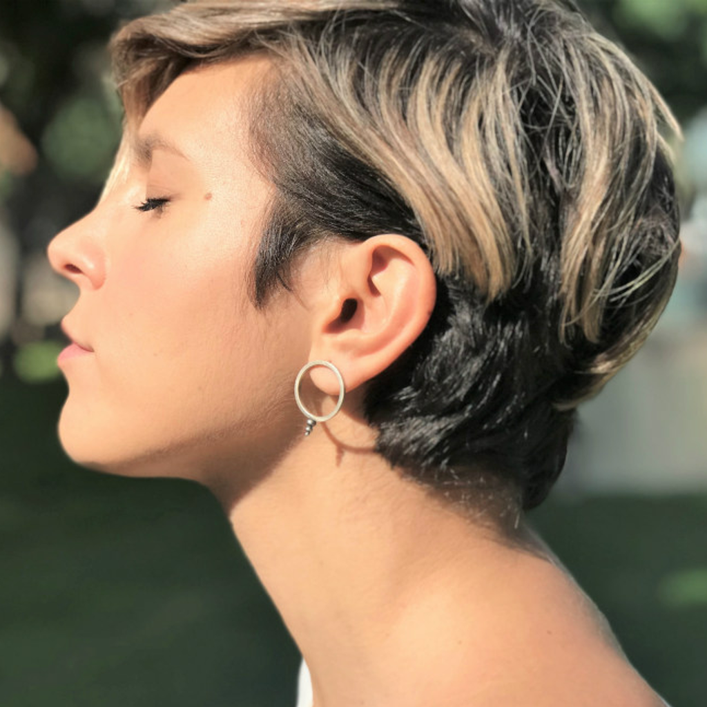 Model wearing Zen Circle Designer Earrings on IndieFaves