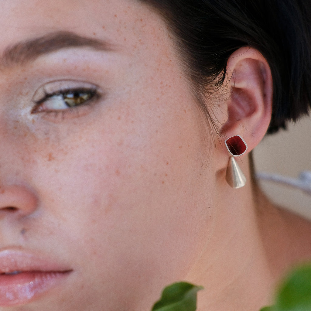 Model wearing Anja Berg - Silver and Red Enamel Chalice Designer Earrings on IndieFaves