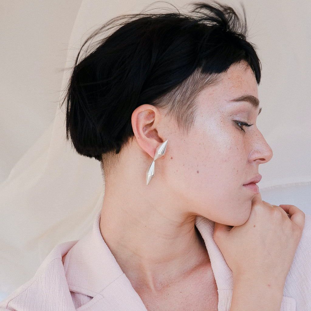 Model wearing Anja Berg - Silver and Red Enamel Directional Designer Earrings on IndieFaves