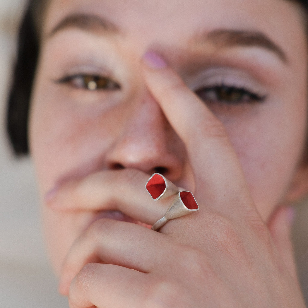 Model wearing Anja Berg - Silver and Red Enamel Interlaced Bells Designer Ring on IndieFaves