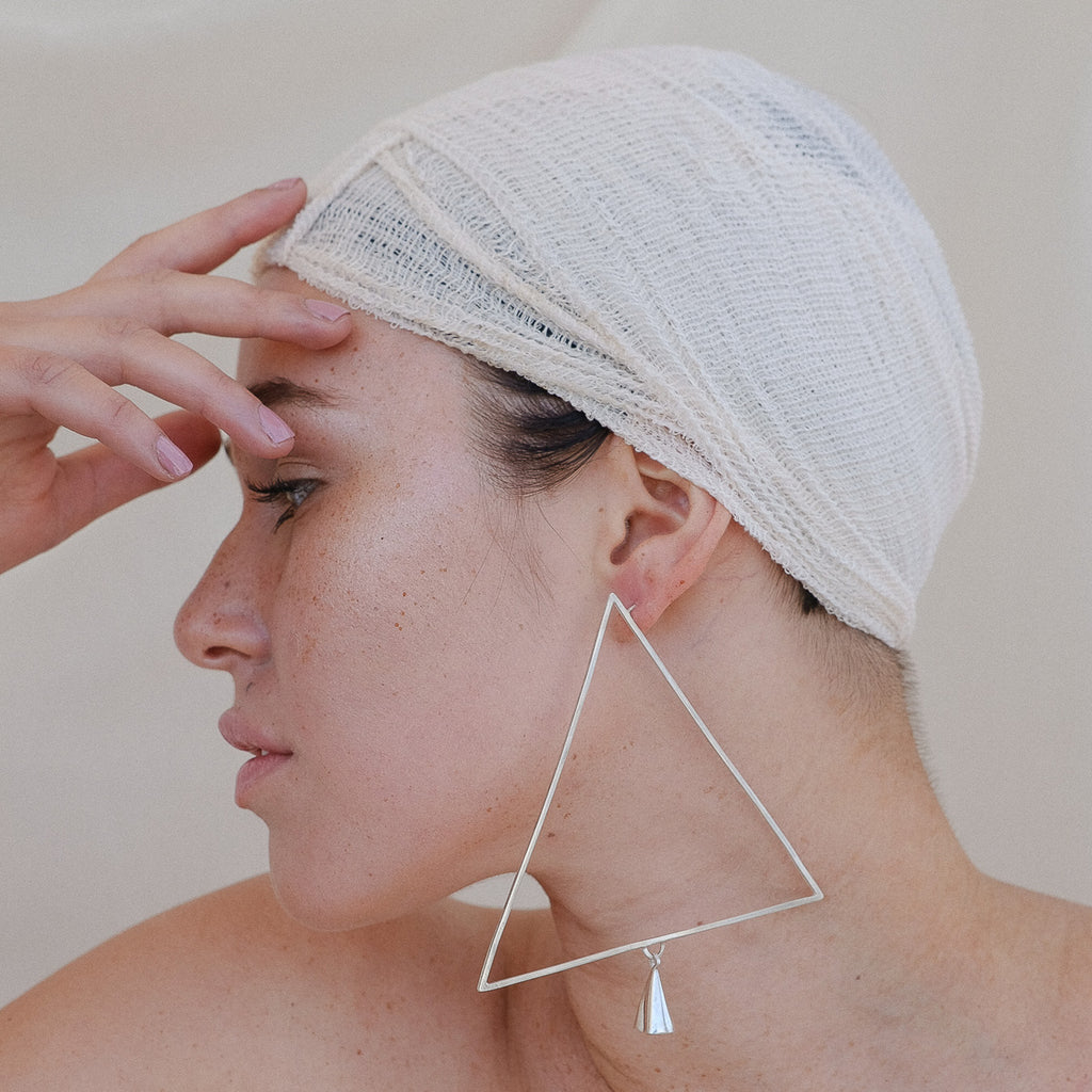 Model wearing Anja Berg - Silver and Red Enamel Light Triangle Designer Earrings on IndieFaves