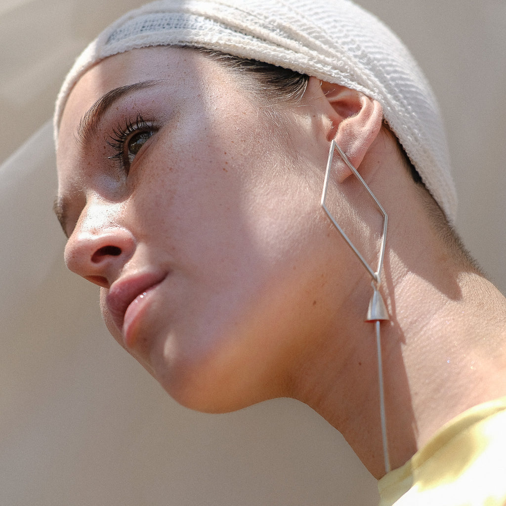 Model wearing Anja Berg - Silver and Red Enamel Like A Kite Designer Earrings on IndieFaves